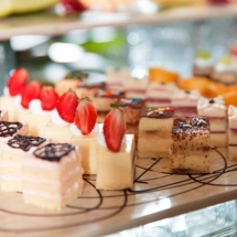Delicious Mini Cakes on Buffet Table