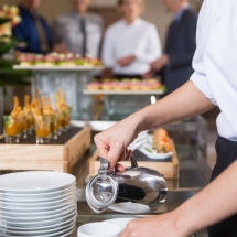 Waitress Serving Coffee in Buffet Restaurant