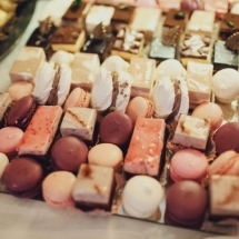 delicious colorful macaroons and cakes on the wedding candy bar